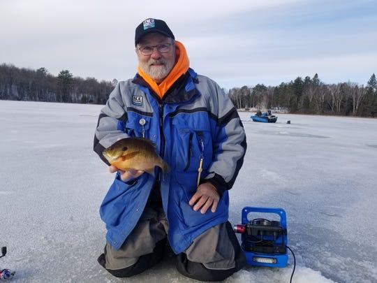 Rick Johnson shows off a colorful bluegill from a lake near Bigfork, Minnesota.