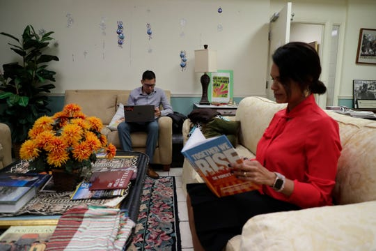 Julio Calderon, campaign manager with We Are Florida and Melissa Taveras, media and government relations manager with the Florida Immigrant Coalition, work and read together in the lobby of the Florida People's Advocacy Center where they stayed during a committee week Wednesday, Dec. 11, 2019.