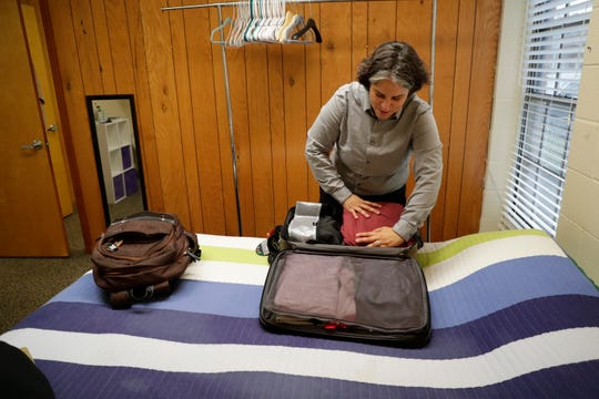 Charo Valero, the Florida state policy director for the Florida Latina Advocacy Network, packs up her belongings in the room she stayed in at the Florida People's Advocacy Center during a committee week before heading back to Miami Wednesday, Dec. 11, 2019.
