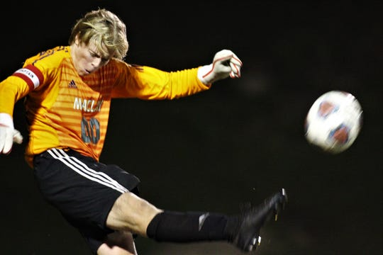 Maclay senior keeper Hudson Williams punts the ball as Maclay pulled out a 1-0 road victory over Leon on Dec. 10, 2019.