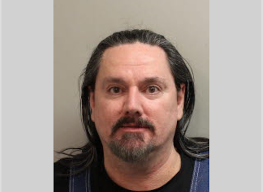 John McLeod, 55, was arrested for discharging a firearm in public from a vehicle within 1,000 feet of any person on Wednesday, Dec. 11, 2019.