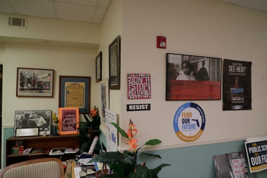 The lobby of the Florida People's Advocacy Center in Tallahassee is decorated with posters and artwork that centers on the theme of the social justice work that those who stay there do.