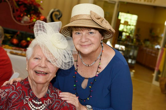 Joan Garman, left, and Gwen Cunningham enjoy the 2019 Christmas Tea at the Port St. Lucie Botanical Gardens, benefiting Sarah's Kitchen.