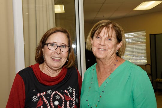Sarah's Kitchen Executive Director Julie Summers, left, and Nancy Landry enjoy the 2019 Christmas Tea at the Port St. Lucie Botanical Gardens, benefiting Sarah's Kitchen.