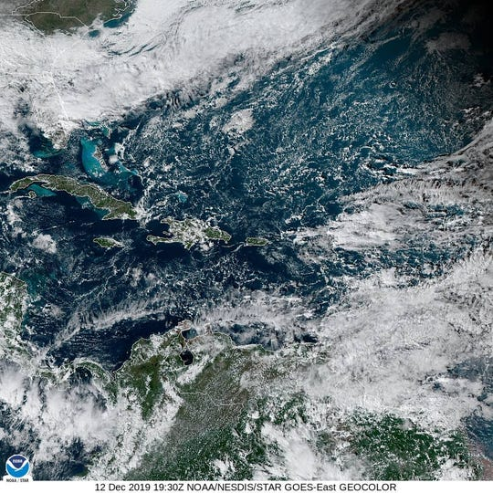 NOAA satellite imagery from Dec. 12, 2019 show weather systems covering the state and those that brought record rains to areas of the Treasure Coast.