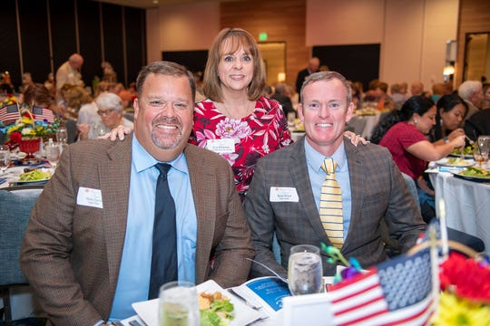 Brett Zurich, left, Evie Klaassen and Ryan Strom at the Salvation Army Women's Auxiliary's Wings of Hope luncheon and silent auction in Jensen Beach.
