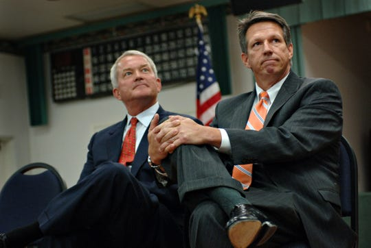 U.S. Rep. Mark Foley, left, sits alongside his opponent, Tim Mahoney, as the two listen to Emmie Ross, a third candidate in the race for the House District 16 seat during a candidate forum Aug. 17, 2006, at St. Christopher's Catholic Church in Hobe Sound.