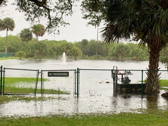 A retention pond in Vero Beach overflows amid heavy rains on Dec. 12, 2019.