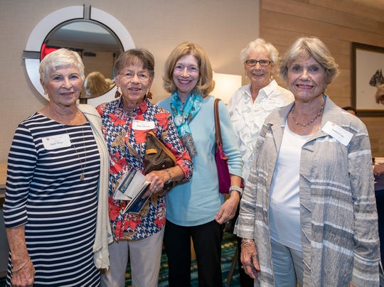 Janet Ozier, left, Mary Stilwell, Patrice Page, Char Meyering and Andrea Lutz at the Salvation Army Women's Auxiliary's Wings of Hope luncheon and silent auction in Jensen Beach.