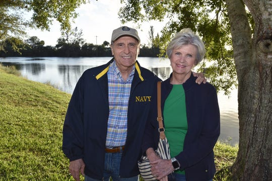 Tony and Karen Vaina enjoy the lake view at Schacht Groves at the Fall Harvest Dinner.