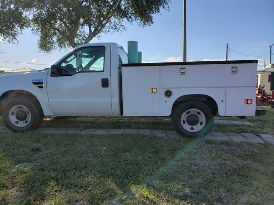 This is a 2008 Ford F250 Super Duty regular cab truck auto dealer Eric Jones of Auto Care Center in Fort Pierce wants to include in a three vehicle package to the county to settle a lawsuit for $177,217 for unpaid rent and utilities.