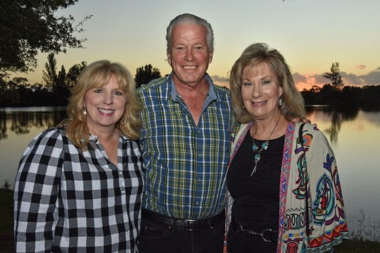 Treasure Coast Food Bank President and CEO Judith Cruz, left, with Paul Genke and Lila Blakeslee at the Fall Harvest Dinner at Schacht Groves in Indian River County.