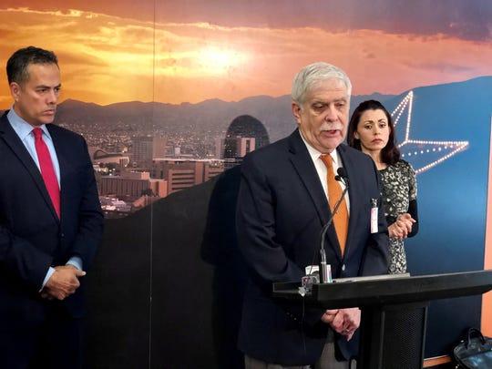 Norman Gordon, an El Paso attorney working for the city of El Paso on El Paso Electric sale negotiations, talks at a Dec. 11 press conference. El Paso City Manager Tommy Gonzalez and City Attorney Karla Nieman listen.