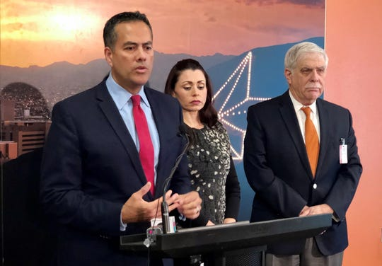 El Paso City Manager Tommy Gonzalez, City Attorney Karla Nieman, and Norman Gordon, an El Paso attorney working for the city on El Paso Electric sale negotiations.