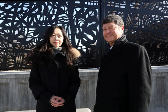 Yaling Chen, the deputy director for MTA Arts & Design, and Michael Feinberg, the MTA's director of tunnels, bridges and track, at the recently unveiled art by Frances Gallardo in Mount Vernon on Dec. 12, 2019.