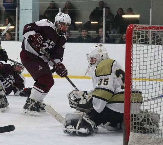 Scarsdale's Danny Stonberg scores on Clarkstown goalie Michael Callanan during their game at Palisades Center Dec. 11, 2019.