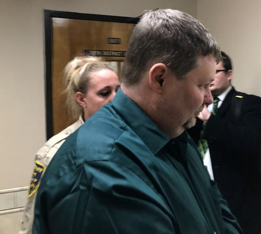 Jason Wayne Carlile, 48, leaves 78th District Court in handcuffs Thursday morning where he was convicted of eight child sex crimes and sentenced to life in prison and $80,000 in fines this week. Carlile was being taken to Wichita County Jail.
