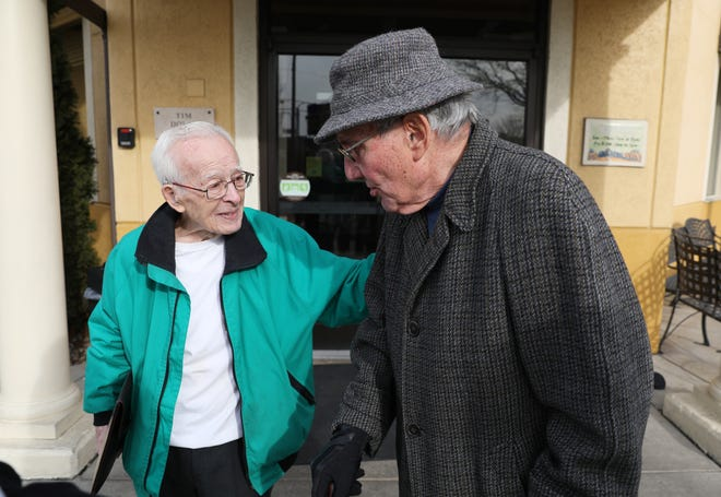 Joe Pishner, left, says goodbye to fellow WWII veteran Bill McClelland after the two met at Olive Garden in Zanesville for lunch. Pishner, an Army veteran, and McClelland, an Air Force veteran, both served in the European Theater.