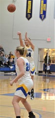 Maysville's Bailee Smith launches a 3, which she made to surpass 1,000 career points in Wednesday's game against John Glenn. The Panthers won 59-27.