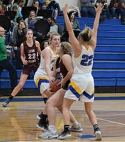 Maysville's Alexis Samson tries to rip the ball away from John Glenn's Layni Gillespie in Wednesday's game. Maysville won 59-27.