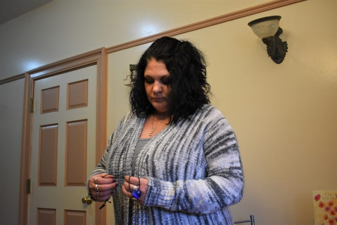 Tammy Clark of Homeless Hands of Zanesville holds the necklace Sabrina Bailey was wearing at the time of her death. The necklace, along with about $3,600 raised by the community through a Homeless Hands fundraiser, will be left to Sabrina's daughter Iris.