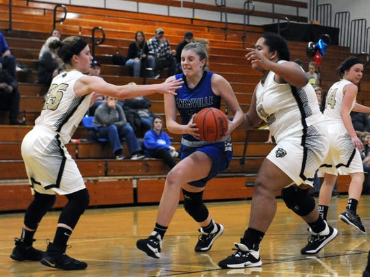Zanesville's Madison Winland drives into the lane against River View's Jessica Hartsock, left, and Aaliyah Better on Wednesday night in Warsaw.