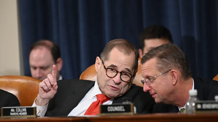 House Judiciary Committee Chairman Rep. Jerrold Nadler speaks with Ranking Member Doug Collins, R-GA, during the House Judiciary Committee markup of H.Res. 755, Articles of Impeachment Against President Donald J. Trump in Washington, DC on Dec. 12, 2019.