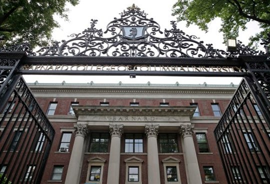 In this Thursday, May 28, 2015 photo, a gate over the entrance of Barnard College is seen in New York.
