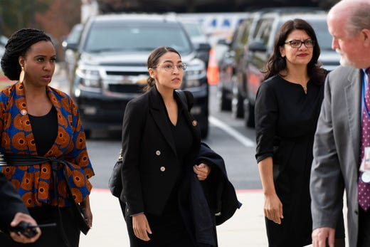 US Reps. Rashida Tlaib, right, Ayanna Pressley, left, and Alexandria Ocasio-Cortez, center, walk to the entrance of the funeral of Rep. Elijah Cummings at the New Psalmist Baptist Church in Baltimore on Oct 25, 2019.
