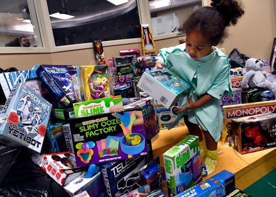 Ariana Smith, 2, picks out a toy for herself Friday at Hendrick Children's Hospital. More than 2,000 toys were donated to the hospital by members of the Texas State Guard.