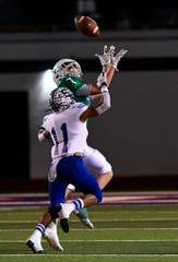 Hamlin defensive back Austin Brown intercepts a pass meant for Stratford's Luden Romero during the Pied Pipers' Class 2A Division II semifinal game Thursday in Plainview.