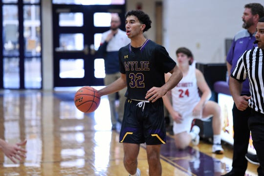 Wylie's Payton Brooks (32) looks up after bringing the ball down the court against Georgetown East View during pool play of the Catclaw Classic at Bulldog Gym on Friday. Brooks has been the Bulldogs' leading scorer in all 11 games this season and is averaging 18.9 on the year.