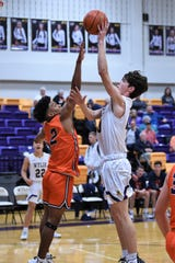 Wylie's Walker Piland (40) puts up a shot over Brook Hill's Joseph Johnson (2) during the first day of the Catclaw Classic at Bulldog Gym on Thursday, Dec. 12, 2019. The Bulldogs won 52-29.