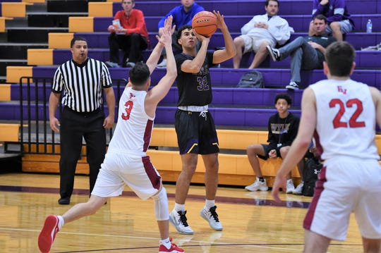 Wylie's Payton Brooks (32) lines up a 3-point shot against Georgetown East View during pool play of the Catclaw Classic at Bulldog Gym on Friday. Brooks knocked down five 3-pointers and finished with 18 points in the 65-41 win.