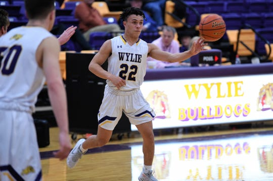 Wylie point guard Shayden Payne (22) pushes a pass against Brook Hill during the first day of the Catclaw Classic at Bulldog Gym on Thursday, Dec. 12, 2019. The Bulldogs won 52-29.