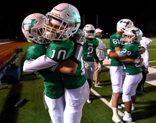Hamlin teammates Alex Alarcon (left) and Austin Castillo (10) celebrate the Pied Piper's victory over Stratford during the Class 2A Div. II semifinal game in Plainview Thursday Dec. 12, 2019. Final score was 56-23, Hamlin.