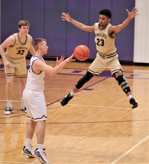 Abilene High's D.J. Modest (23) tries to block a pass by a Midland Christian player as Nathan Watts (32) looks on. The Mustangs beat AHS 43-39 at the Catclaw Classic on Thursday, Dec. 12, 2019, at Wylie's Bulldog Gym.