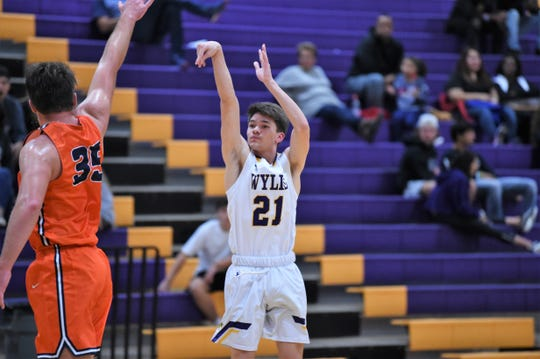 Wylie's Dylan Jennings (21) follows through on a 3-pointer against Brook Hill during the first day of the Catclaw Classic at Bulldog Gym on Thursday, Dec. 12, 2019. The Bulldogs won 52-29.