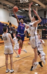 Cooper's Deshawn McDonald (1) drives to the basket in the first half against the Canyon defense. Cooper beat the Eagles 66-65 to wrap the first day of the Catclaw Classic 2-0 on Thursday, Dec. 12, 2019, at Wylie's Bulldog Gym.