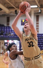 Abilene High's Nathan Watts (32) drives to the basket against a Midland Christian defender in the first half. Midland Christian beat the Eagles 43-39 at the Catclaw Classic on Thursday, Dec. 12, 2019, at Wylie's Bulldog Gym.