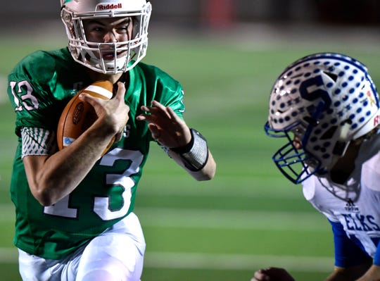 Hamlin quarterback Brandon Warner scrambles through the Stratford line for a touchdown during the Pied Pipers' Class 2A Div. II semifinal game against the Elks in Plainview Thursday.