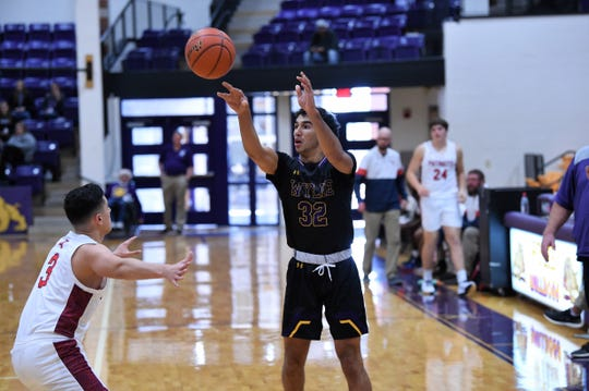 Wylie's Payton Brooks (32) passes the ball against Georgetown East View during pool play of the Catclaw Classic at Bulldog Gym on Friday afternoon. Brooks scored 18 points in the 65-41 win as his season average is 18.9 points per game through 11 games.