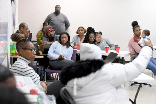 """Members of the youth organization My Daddy Taught Me That and My Sistah Taught Me That listen as Korey Wise gives a talk at their space in the Asheville Mall on Dec. 12, 2019. Wise is one of the five people who were wrongly convicted in the Central Park jogger case in New York and spent about 14 years in prison for a crime he didn't commit. Wise will be giving a """"Reality Check"""" talk titled """"Pipeline to Prison"""" on Dec. 13."""