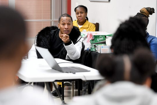 """Korey Wise gives a talk to members of the youth organization My Daddy Taught Me That and My Sistah Taught Me That at their space in the Asheville Mall on Dec. 12, 2019. Wise is one of the five people who were wrongly convicted in the Central Park jogger case in New York and spent about 14 years in prison for a crime he didn't commit. Wise will be giving a """"Reality Check"""" talk titled """"Pipeline to Prison"""" on Dec. 13."""