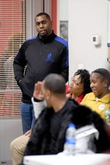 """Keynon Lake, founder of My Daddy Taught Me That asks Korey Wise a question as he gives a talk at their space in the Asheville Mall on Dec. 12, 2019. Wise is one of the five people who were wrongly convicted in the Central Park jogger case in New York and spent about 14 years in prison for a crime he didn't commit. Wise will be giving a """"Reality Check"""" talk titled """"Pipeline to Prison"""" on Dec. 13."""