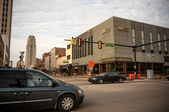 Traffic flows through downtown on the corner of Michigan Ave. and Capital Ave. on Friday, Dec. 13, 2019 in Battle Creek, Mich. Michigan Avenue reopened that morning for the first time since November 2018.