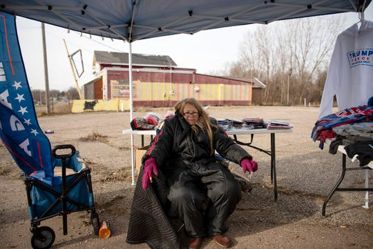 """Violet Rozanski sells Trump merchandise on Friday, Dec. 13, 2019 in Battle Creek, Mich. Donald Trump is hosting a """"Merry Christmas"""" rally Dec. 18 at the Kellogg Arena on McCamly Square."""