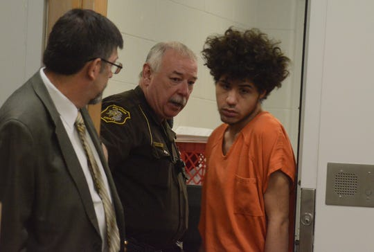 Tyler Smith enters the courtroom with his attorney, James Sauber, for sentencing on a July armed robbery.