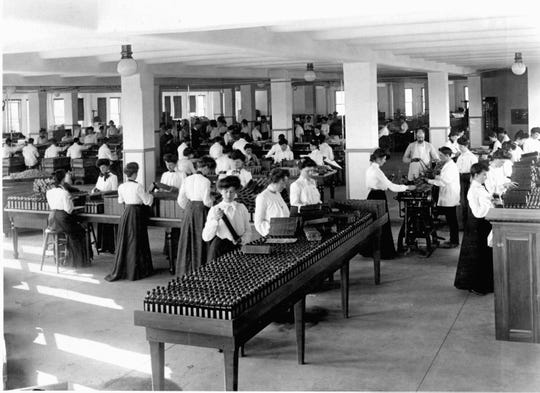Female workers at the Dr. Kilmer & Co. wearing full skirts while working, about 1910.