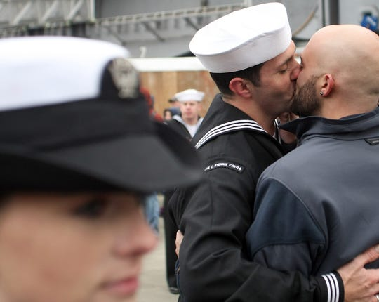 "Sailor Jonathan Jewell, is greeted with a kiss by boyfriend Sean Sutton after the USS John C. Stennis returned to Naval Base Kitsap Bremerton on Friday, March 2, 2012. The previous year marked the end of ""Don't Ask, Don't Tell."" (MEEGAN M. REID / KITSAP SUN)"